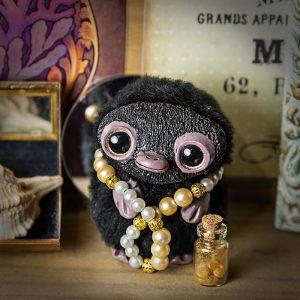 artdoll niffleur animaux fantastiques pate polymere fausse fourrure noir bijoux