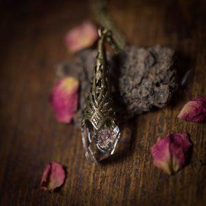 collier pendule resine fleur séchée phosphorescent rose bronze