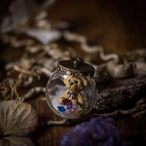 collier globe verre ourson fausse fourrure