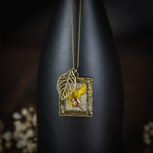 collier cadre bronze lin resine fleur séchée feuille
