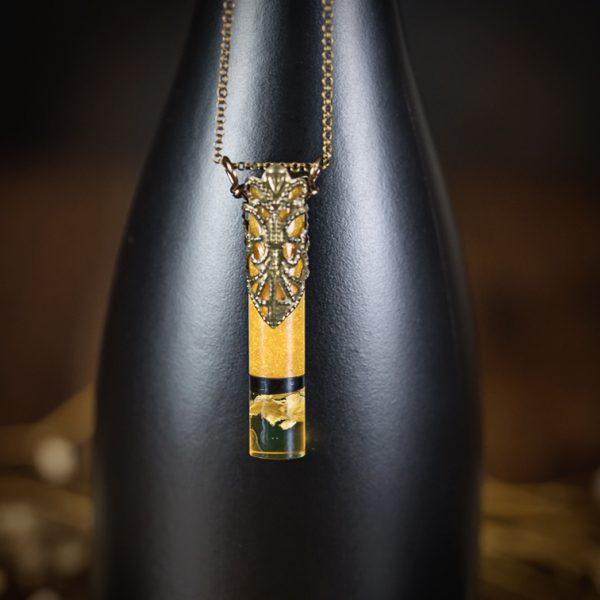 collier resine tube muguet bronze noir doré paillettes
