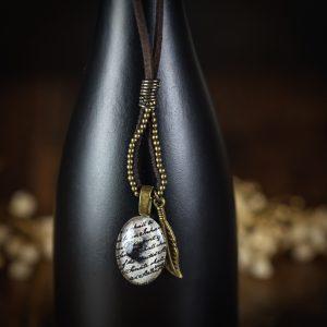 collier cabochon suedine plume bronze