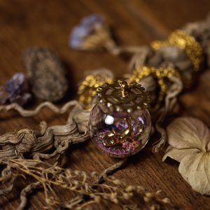 collier globe verre chat bronze rose paillettes