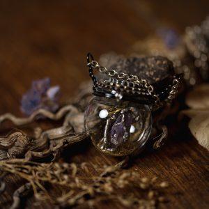 collier globe verre amethyste rouage soudure