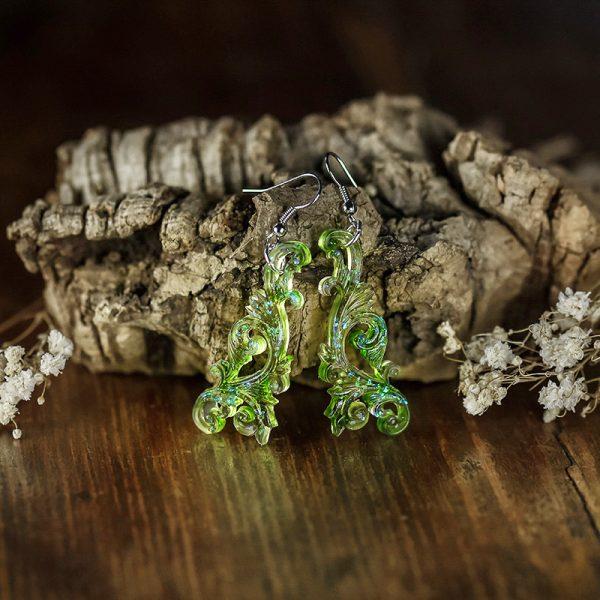 boucles d'oreilles arabesques vert resine paillettes