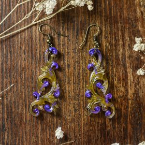 boucles d'oreilles arabesques doré violette paillettes resine bronze